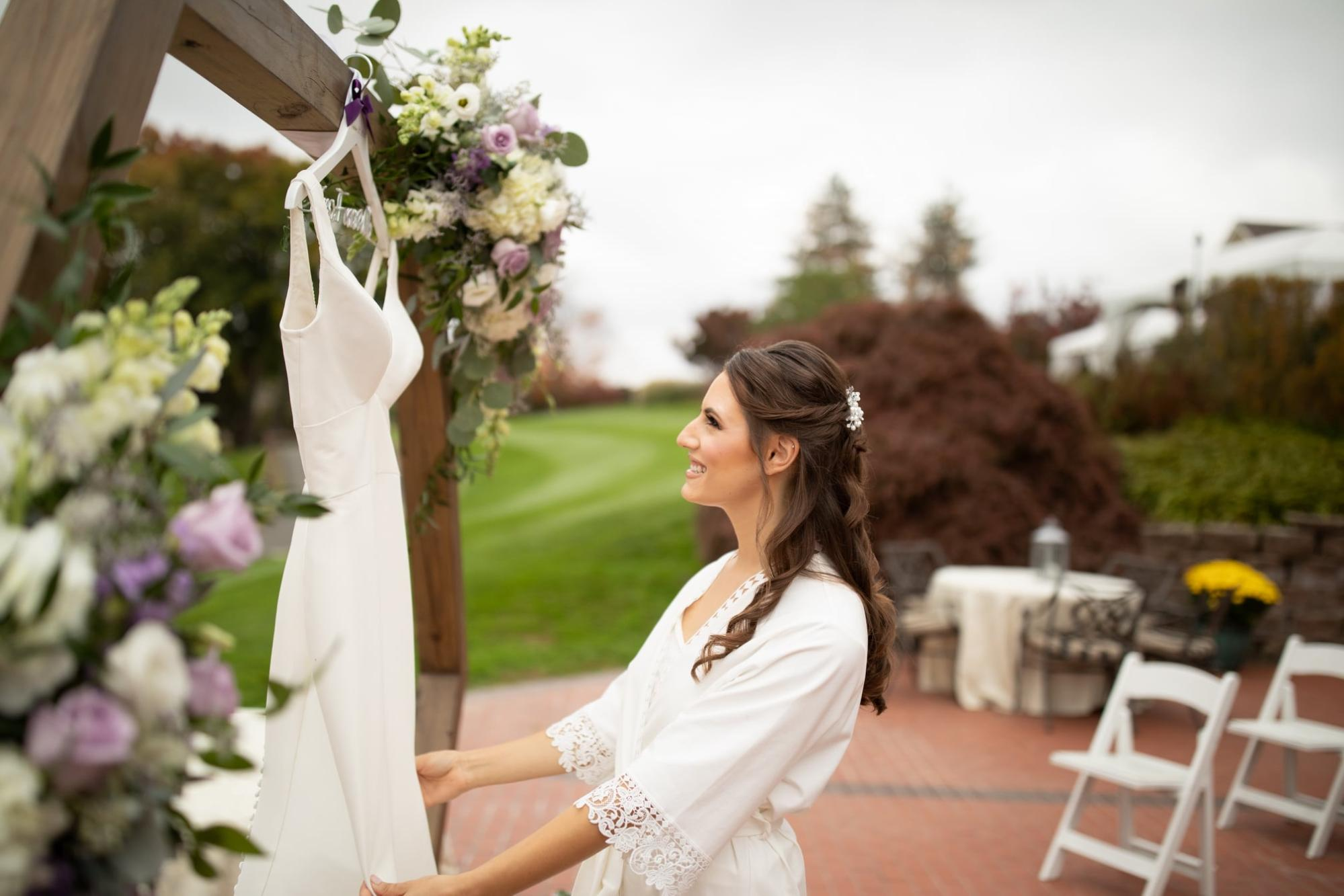 Bride on wedding day at outdoor ceremony and reception in Northern NJ at Brooklake