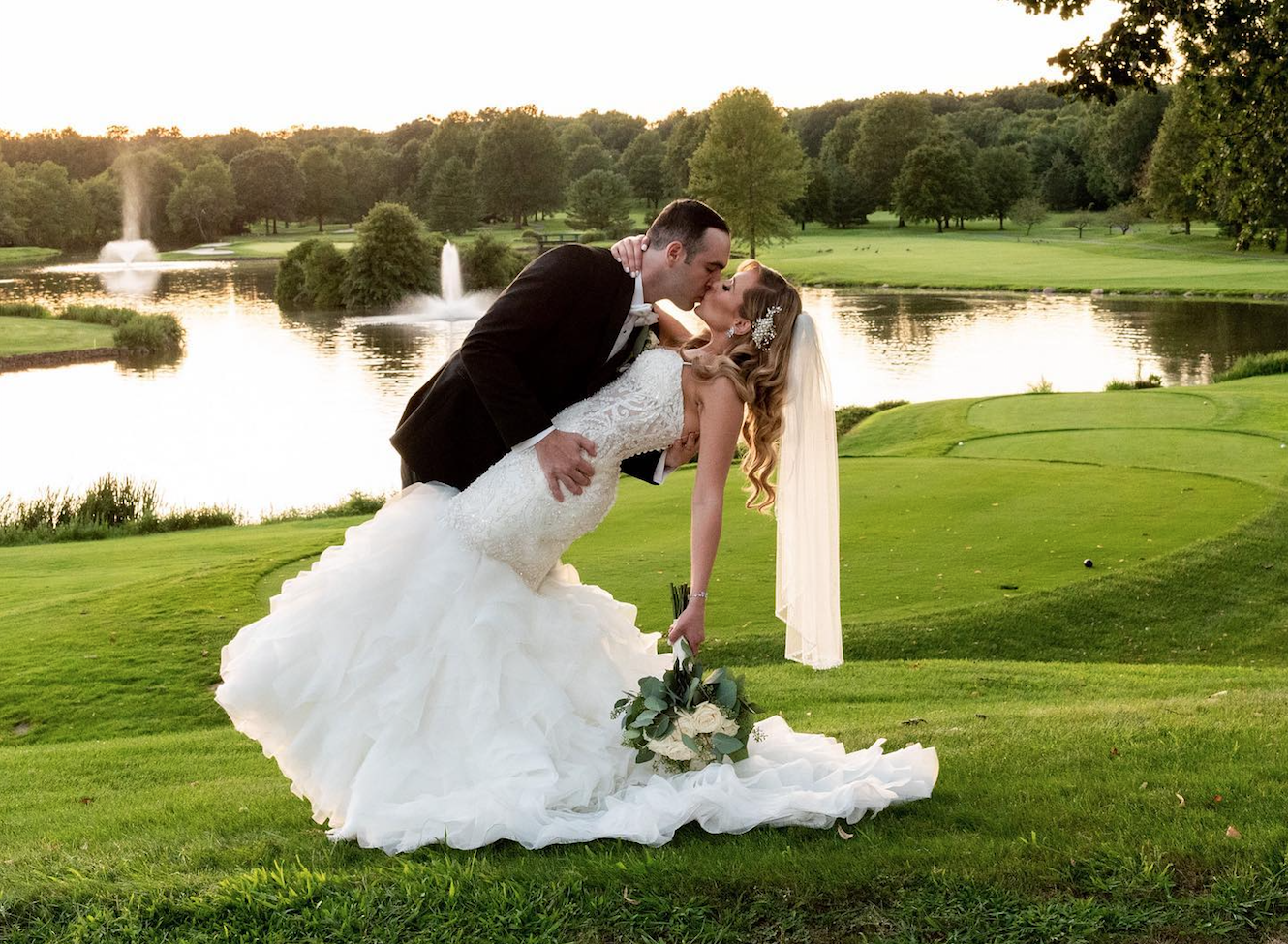 Bride and groom by lake at Brooklake wedding ceremony, Northern New Jersey
