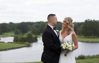 Bride and groom outdoors by the lake at Brooklake in Northern NJ