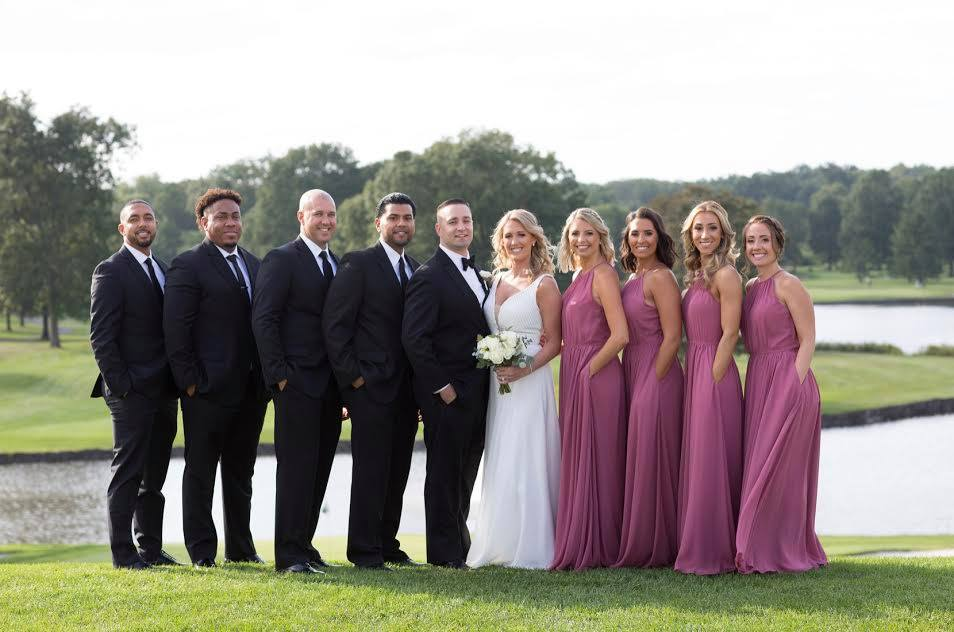 Wedding party outdoors by lake at Brooklake in Northern NJ